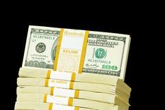 Pila di dollari isolati Fotografia Stock