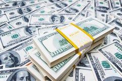 Pila di dollari su soldi Fotografia Stock Libera da Diritti
