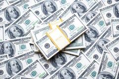 Pila di dollari su soldi Fotografie Stock Libere da Diritti