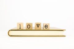 Pila di espressione di amore su un libro Fotografia Stock Libera da Diritti