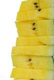 Pila di fette gialle dell'anguria Immagini Stock