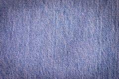 Pila di fondo delle blue jeans Immagine Stock