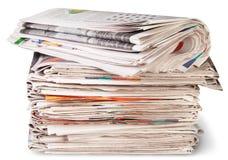 Pila di giornali e del rotolo Fotografia Stock