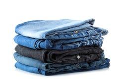 Pila di jeans Immagini Stock