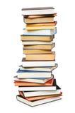 Pila di libri isolati Immagine Stock