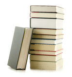 Pila di libri isolati su bianco Immagine Stock