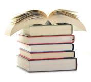 Pila di libri isolati su bianco Fotografia Stock