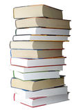 Pila di libri isolati su priorità bassa bianca. Fotografie Stock