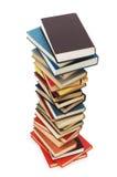 Pila di libri isolati sui precedenti bianchi Immagine Stock Libera da Diritti
