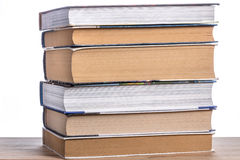 Pila di libri su una tavola di legno Fotografia Stock