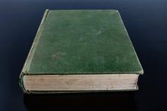 Pila di libri in un fondo bianco fotografia stock