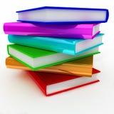 Pila di libri variopinta sopra priorità bassa bianca Immagine Stock