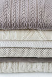 Pila di maglioni leggeri caldi Immagini Stock