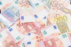 Pila di molte euro banconote Fotografia Stock