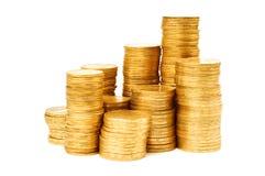 Pila di monete isolate su bianco Fotografie Stock Libere da Diritti