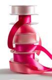 Pila di nastro rosa del raso Fotografie Stock
