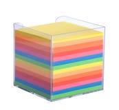 Pila di note multicolori in una scatola di plastica fotografia stock libera da diritti