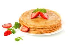 Pila di pancake. crepes con con burro e lo streptococco immagine stock libera da diritti