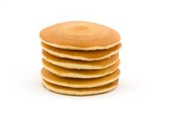 Pila di pancake sopra bianco Fotografia Stock