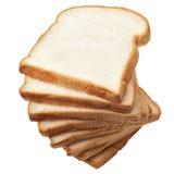 Pila di pane affettato su fondo bianco Fotografie Stock