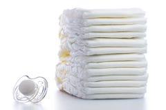 Pila di pannolini e di tettarella Fotografia Stock Libera da Diritti