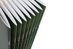 Pila di riviste coperte nere Fotografia Stock