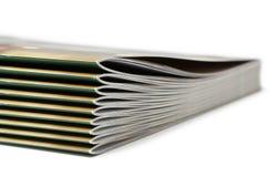 Pila di riviste coperte nere Fotografia Stock Libera da Diritti