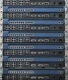 Pila di router e di interruttori Fotografia Stock