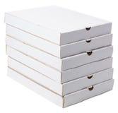Pila di scatole su un fondo bianco Fotografie Stock