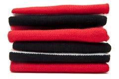 Pila di sciarpe piegate fotografie stock