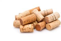 Pila di sugheri del vino su bianco Fotografia Stock