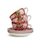 Pila di tazze di tè con i piattini Immagine Stock Libera da Diritti