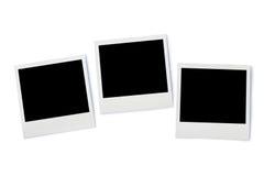 Pila di telai istantanei della foto, isolata su fondo bianco Immagine Stock