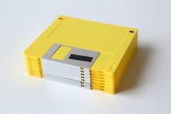 Pila di vecchi floppy disk - giallo Fotografia Stock Libera da Diritti