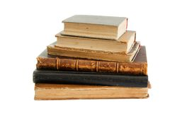 Pila di vecchi libri isolati Fotografie Stock Libere da Diritti