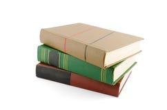 Pila di vecchi libri isolati su bianco Fotografia Stock
