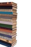 Pila di vecchi libri isolati su fondo bianco Immagini Stock Libere da Diritti