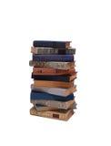 Pila di vecchi libri isolati su fondo bianco Immagini Stock