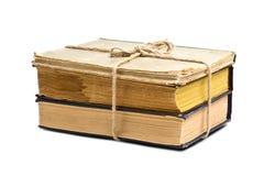 Pila di vecchi libri legati con la corda Fotografie Stock Libere da Diritti