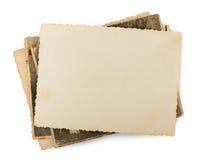 Pila di vecchie foto isolate Fotografia Stock
