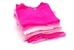 Pila di vestiti della ragazza Fotografia Stock