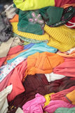 Pila di vestiti della seconda mano Immagine Stock
