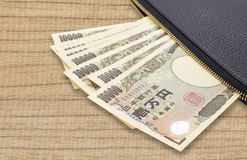 Pila di Yen giapponesi di valuta Immagine Stock