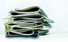 Pila doblada de papeles del negocio, legales o del seguro imagen de archivo