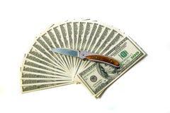 pila e coltello del ventilatore di 100 banconote in dollari Fotografie Stock Libere da Diritti