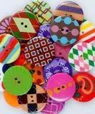 Pila enrrollada de botones Foto de archivo libre de regalías