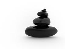 Pila equilibrada de piedras negras Imagen de archivo libre de regalías