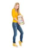 Pila feliz de la explotación agrícola de la muchacha del estudiante de libros Fotografía de archivo libre de regalías