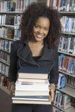 Pila femenina de la tenencia de libros Fotografía de archivo