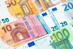 Pila fondo dei soldi di parecchie di euro banconote Fotografie Stock